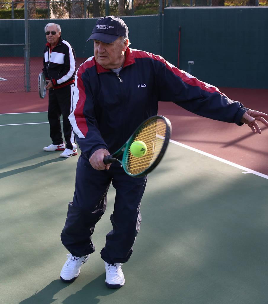 Janos Strauss, 90, returns the ball as his friend Alexander Kuechel, 94, left, both Holocaust survivors, looks on at Mountain Shadows Community Center on Thursday, Dec. 20, 2018, in Las Vegas. Biz ...