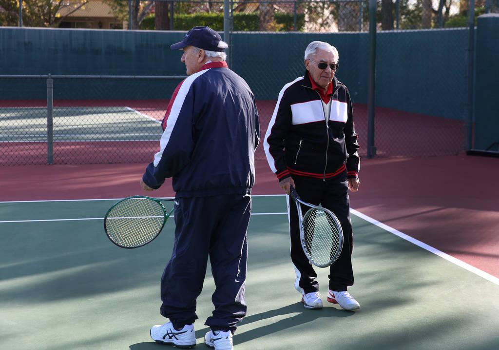 Janos Strauss, 90, left, and his friend Alexander Kuechel, 94, both Holocaust survivors, prepare to play tennis at Mountain Shadows Community Center on Thursday, Dec. 20, 2018, in Las Vegas. Bizua ...