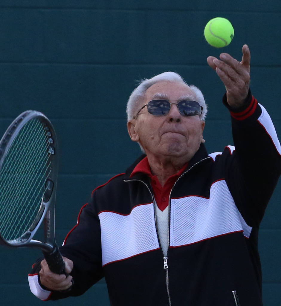 Alexander Kuechel, 94, serves as he plays against his friend, Janos Strauss, 90, not photographed, both Holocaust survivors, at Mountain Shadows Community Center on Thursday, Dec. 20, 2018, in Las ...