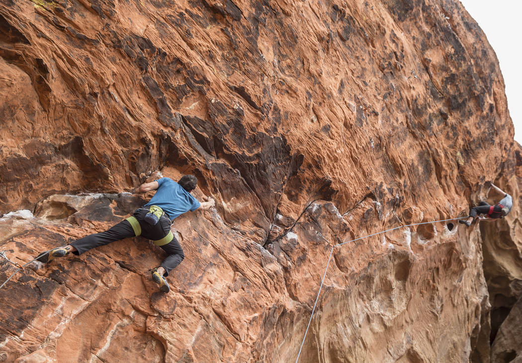 Alex Honnold ascends The Gallery at Red Rock Canyon on Monday, Dec. 17, 2018, in Las Vegas. Honnold, arguably the best rock climber in the world, solo climbed El Capitan, a 3,000-foot granite wall ...