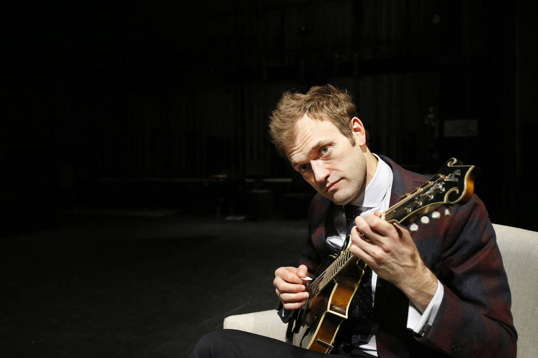 FILE- In this April 5, 2016, file photo, mandolinist Chris Thile plays his mandolin onstage at the Fitzgerald Theater in St. Paul, Minn. Thile announced Saturday, Feb. 18, 2017, that he is returni ...