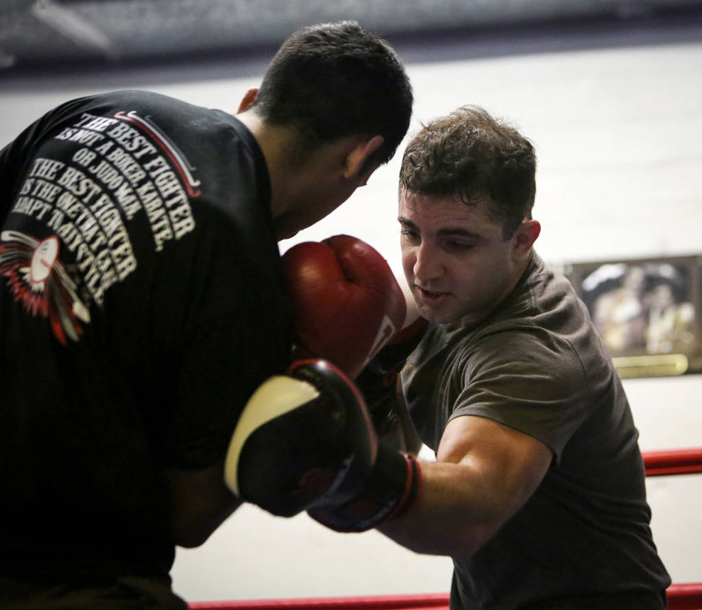 Raji Swidan, right, boxes with Oscar Juarez at Johnny Tocco's Ring Side Boxing Gym in Las Vegas, Thursday, Dec. 27, 2018. Caroline Brehman/Las Vegas Review-Journal