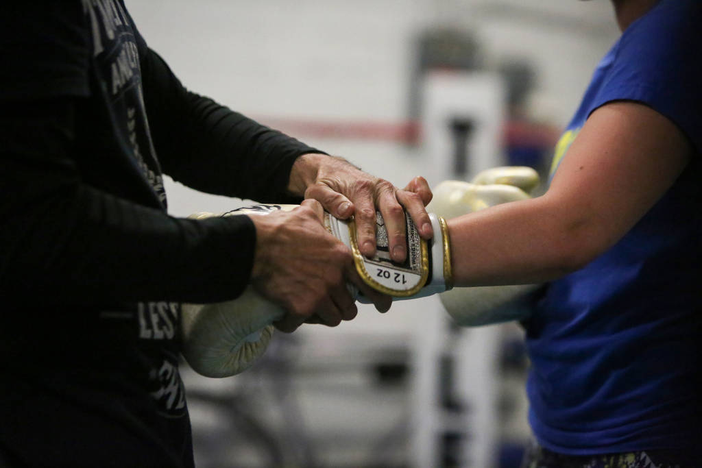 Rodrigo Aranda, left, straps on a boxing glove on Naouel Bourbia's hand as they work out at Johnny Tocco's Ring Side Boxing Gym in Las Vegas, Thursday, Dec. 27, 2018. Caroline Brehman/Las Vegas Re ...