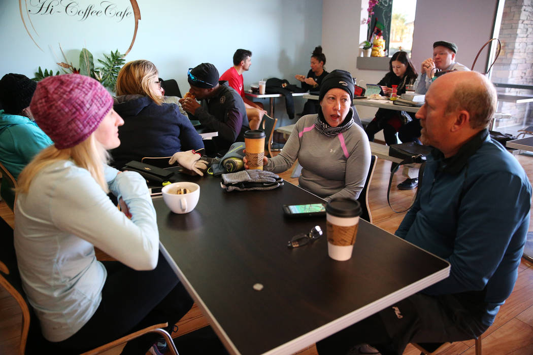 Runners Kat Walsh, from left, Kathleen Dillon, and William Lampe, talk at Hi Coffee Cafe in Henderson after their morning run as part of a meetup group, Saturday, Dec. 29, 2018. Erik Verduzco Las ...
