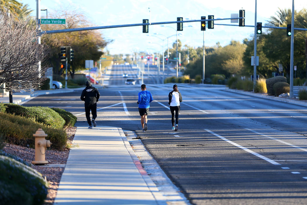 Greg Schulman, from left, Noel Mlynsky, and Maureen Hascher, run on W. Horizon Ridge Parkway in Henderson as part of a runners meetup group, Saturday, Dec. 29, 2018. Erik Verduzco Las Vegas Review ...