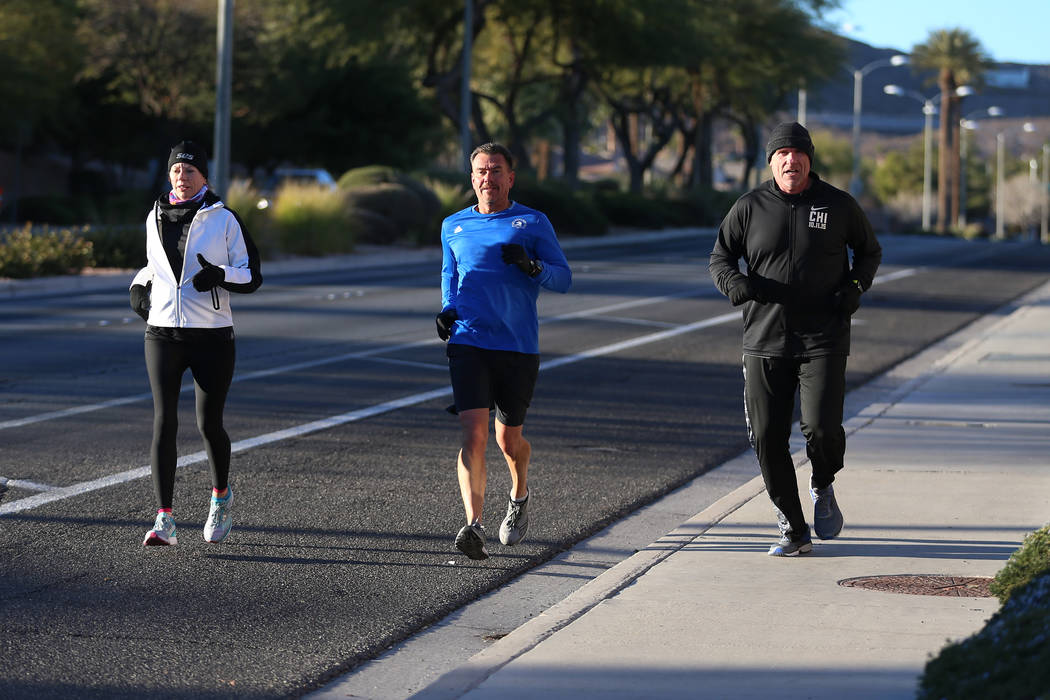 Maureen Hascher, from left, Noel Mlynsky, and Greg Schulman, run on W. Horizon Ridge Parkway in Henderson as part of a runners meetup group, Saturday, Dec. 29, 2018. Erik Verduzco Las Vegas Review ...