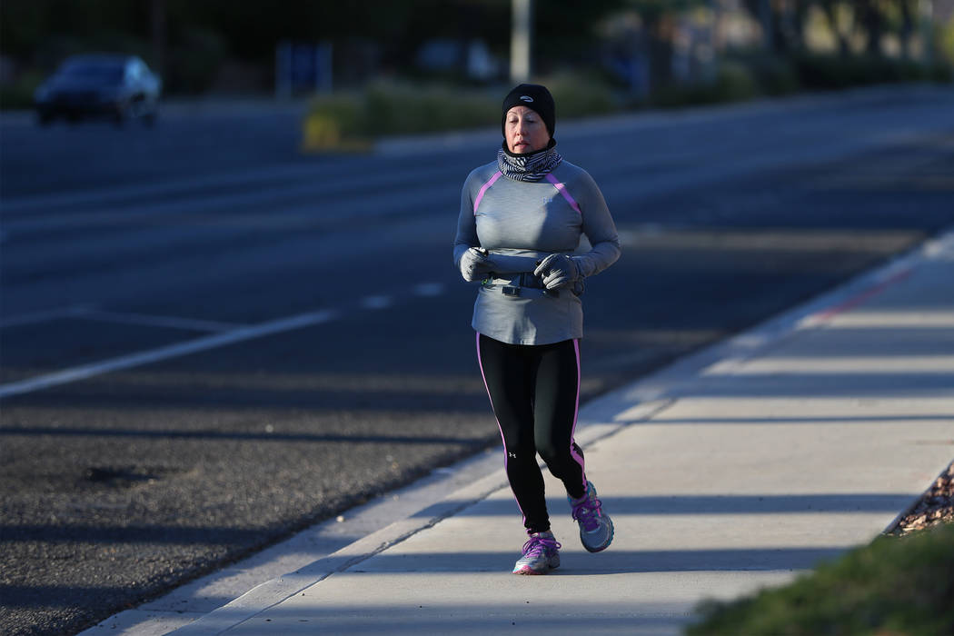 Kathleen Dillon runs on W. Horizon Ridge Parkway in Henderson as part of a runners meetup group, Saturday, Dec. 29, 2018. Erik Verduzco Las Vegas Review-Journal @Erik_Verduzco