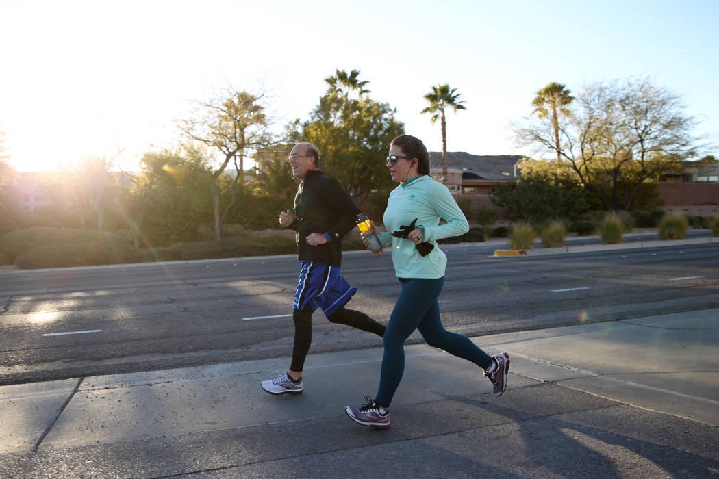 Tim Hunker, left, and Jessica Myers run on W. Horizon Ridge Parkway in Henderson as part of a runners meetup group, Saturday, Dec. 29, 2018. Erik Verduzco Las Vegas Review-Journal @Erik_Verduzco