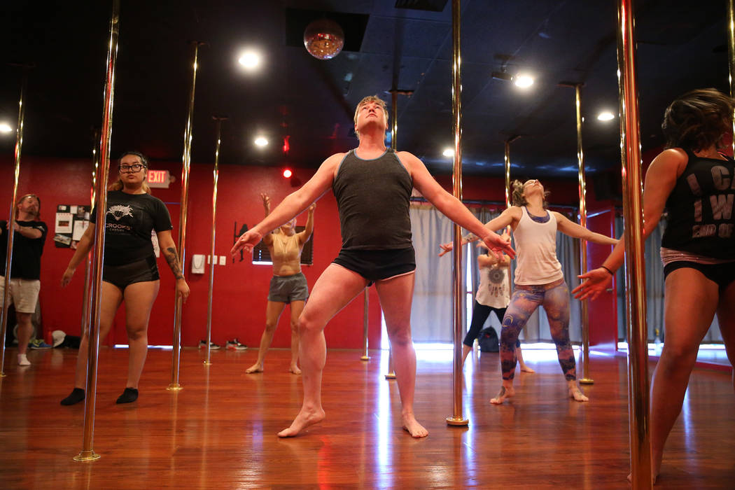 Student Angel Benton, center, dances during a class at Pole Fitness Studio in Las Vegas, Saturday, Dec. 29, 2018. Erik Verduzco Las Vegas Review-Journal @Erik_Verduzco