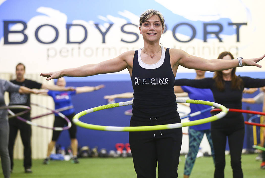 Getti Kehayova leads a hula hoop fitness class at BodySport Fitness in Las Vegas on Saturday, Dec. 29, 2018. Chase Stevens Las Vegas Review-Journal @csstevensphoto