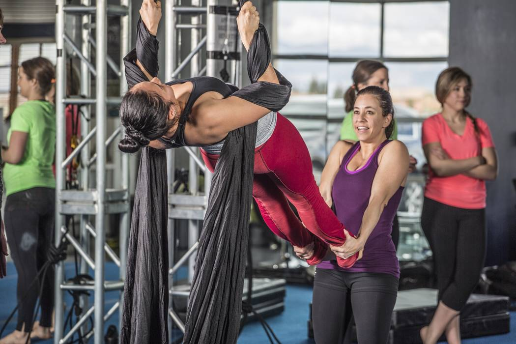 Students practice on aerial silk at Shine Alternative Fitness in Las Vegas, which offers classes in aerial acrobatics taught by current and former performers. (Courtesy of Shine Alternative Fitness).