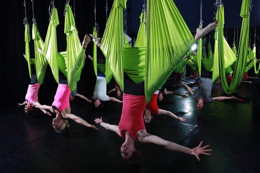 People hang from aerial silk at Shine Alternative Fitness in Las Vegas, which offers classes in aerial acrobatics taught by current and former performers. (Courtesy of Shine Alternative Fitness).