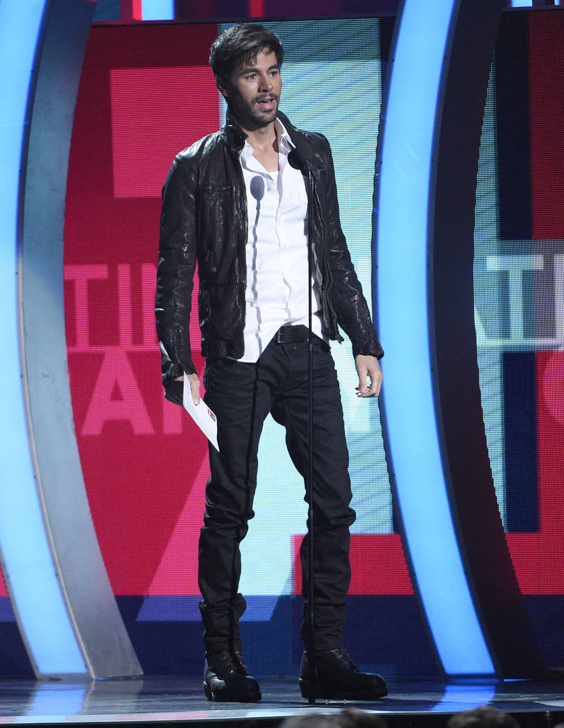 Enrique Iglesias presents the award for best new artist at the 17th annual Latin Grammy Awards at the T-Mobile Arena on Thursday, Nov. 17, 2016, in Las Vegas. (Photo by Chris Pizzello/Invision/AP)