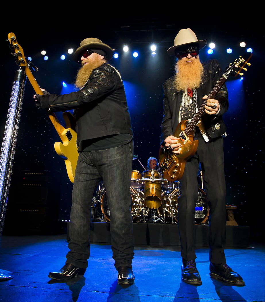 Dusty Hill, left and Billy Gibbons of ZZ Top perform at Blue Hills Bank Pavilion on Sunday, August 28, 2016 in Boston. (Photo by Winslow Townson/Invision/AP)