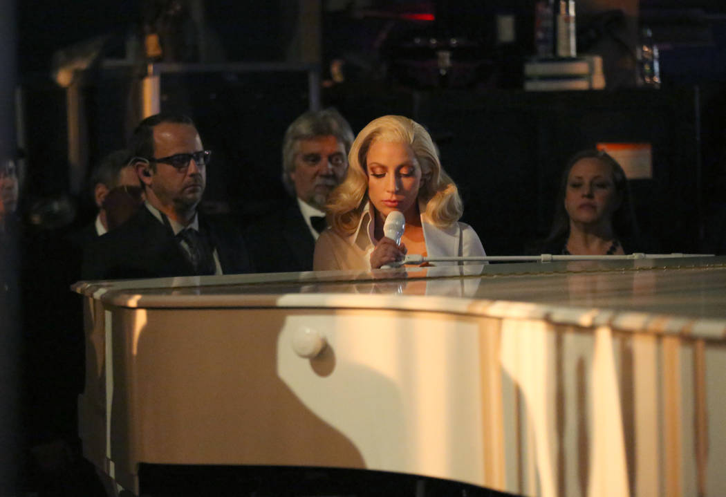 "Lady Gaga is seen from backstage as she performs her nominated song ""Til It Happens To You"" at the Oscars on Sunday, Feb. 28, 2016, at the Dolby Theatre in Los Angeles. (Photo by Matt Sa ..."