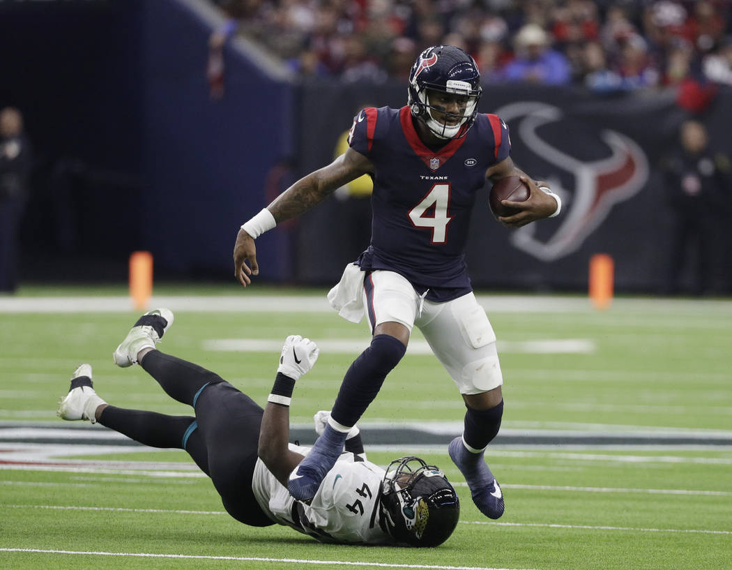 Houston Texans quarterback Deshaun Watson (4) runs past Jacksonville Jaguars middle linebacker Myles Jack (44) during the first half of an NFL football game, Sunday, Dec. 30, 2018, in Houston. (AP ...
