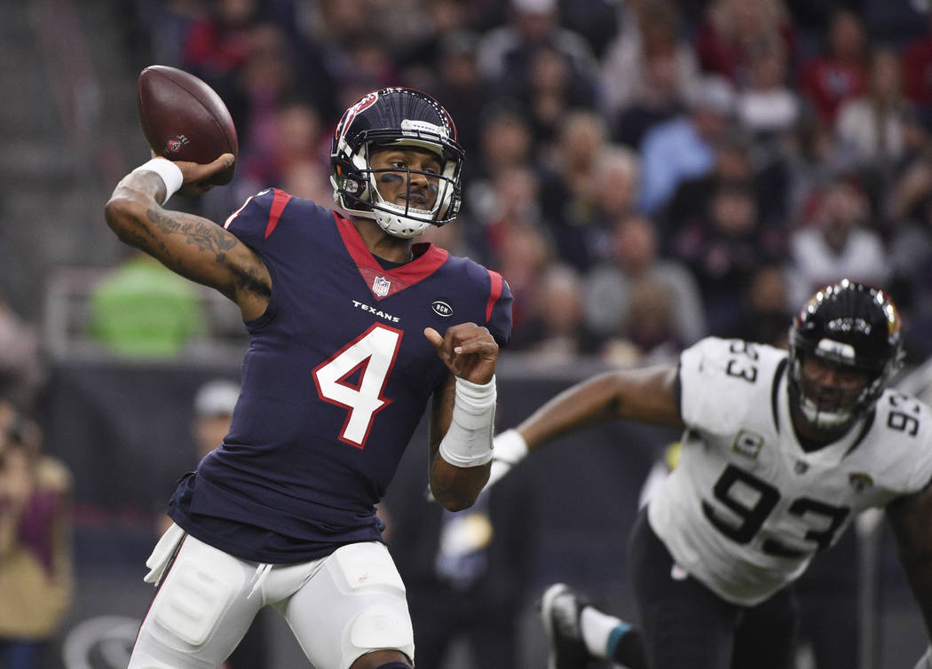 FILE - In this Dec. 30, 2018, file photo, Houston Texans quarterback Deshaun Watson (4) throws a pass against the Jacksonville Jaguars during the first half of an NFL football game in Houston. Wat ...