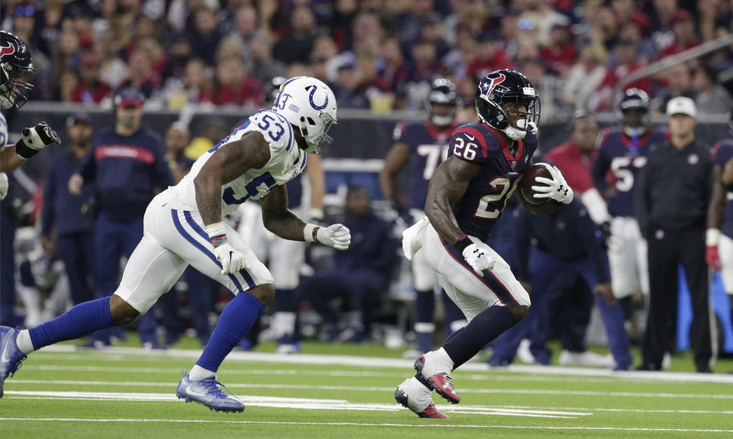 Houston Texans running back Lamar Miller (26) and Indianapolis Colts outside linebacker Darius Leonard (53) during the second half of an NFL wild card playoff football game, Saturday, Jan. 5, 2019 ...