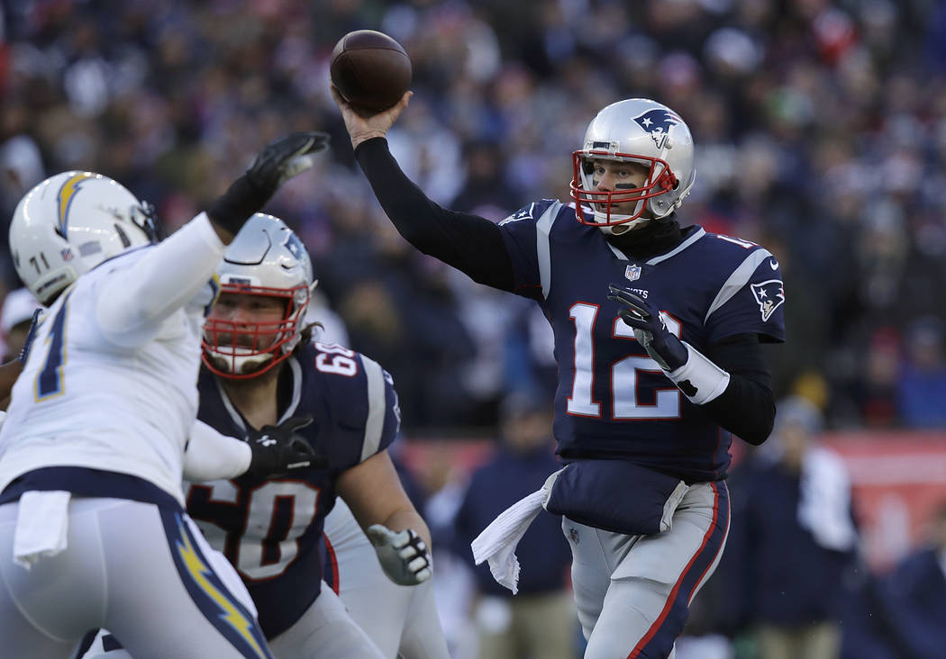 New England Patriots quarterback Tom Brady (12) passes under pressure from Los Angeles Chargers defensive end Damion Square (71) during the first half of an NFL divisional playoff football game, S ...
