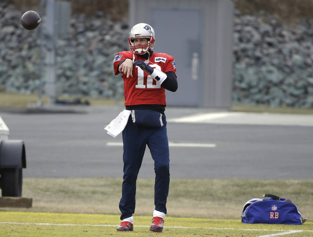 New England Patriots quarterback Tom Brady throws the ball while warming up during an NFL football practice, Wednesday, Jan. 16, 2019, in Foxborough, Mass. The Patriots are scheduled to face the K ...