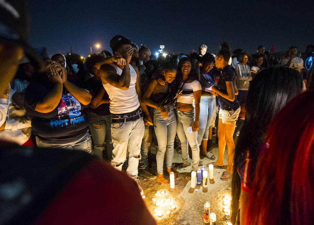 People mourn on Sept. 13, 2018, during a candlelight vigil in memory of Canyon Springs High School student Dalvin Brown, who was shot and killed outside the North Las Vegas school. Chase Stevens L ...