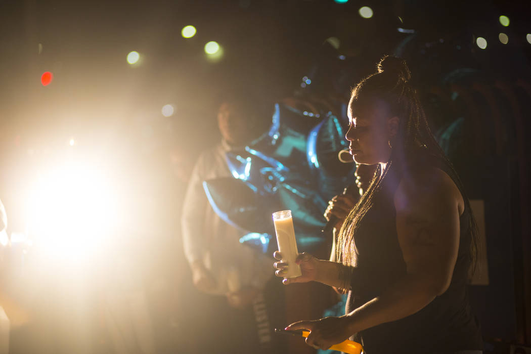 Annie Marshall holds a candle in memory of her son, Dalvin Brown, during a candlelight vigil outside Canyon Springs High School in North Las Vegas on Sept. 13, 2018. Chase Stevens Las Vegas Review ...
