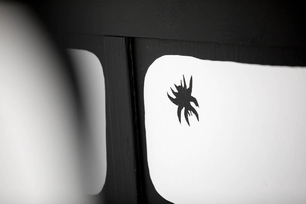Artist Joshua Vides includes a bug on many of his immersive monochromatic rooms. Clint Jenkins