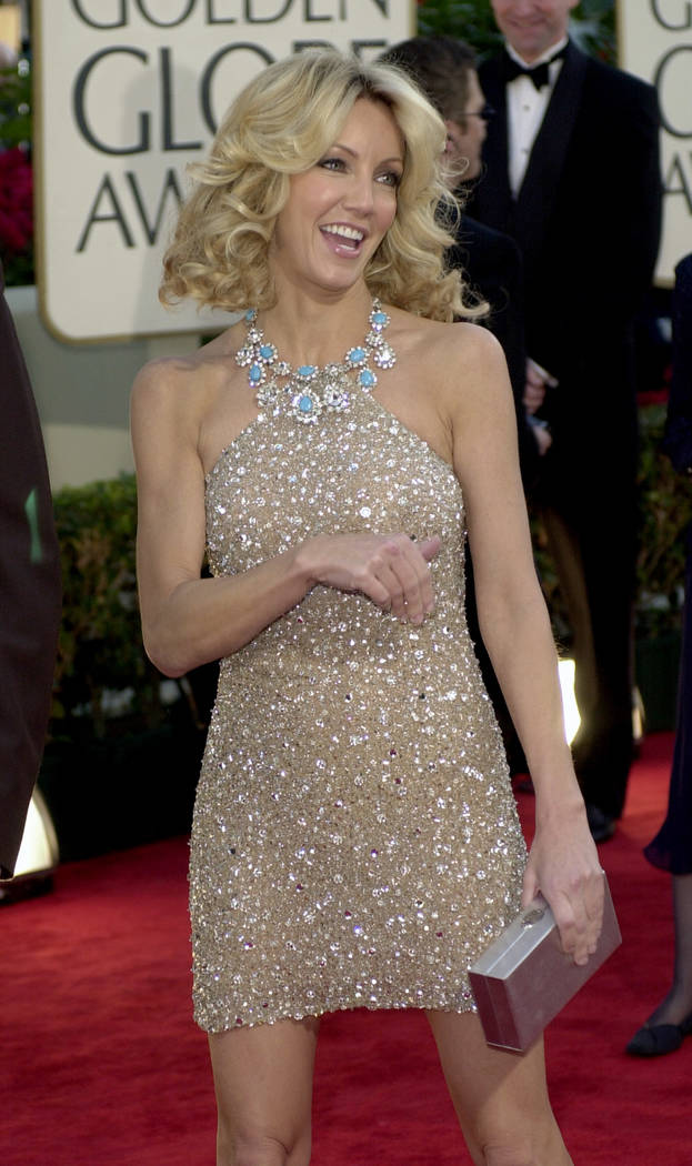 Actress Heather Locklear arrives at the 59th Annual Golden Globe Awards in Beverly Hills, Calif., Sunday, Jan. 20, 2002. Locklear is nominated for best actress in a television series comedy/musica ...