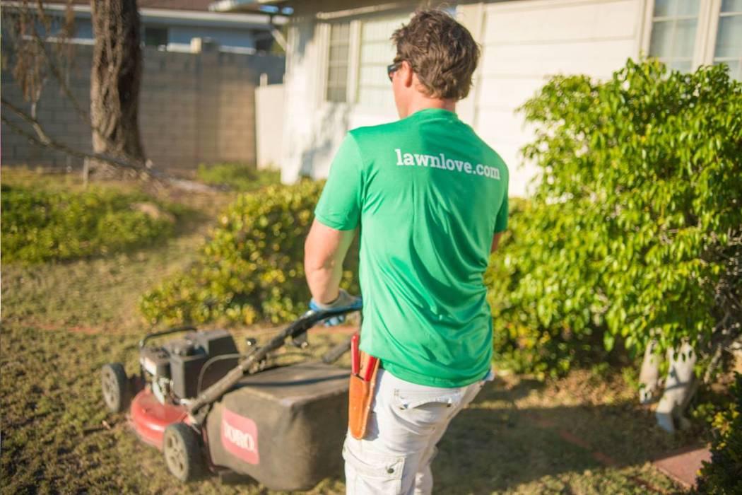 Lawn Love provider Nicholas Poulsen mows a lawn. (Courtesy)