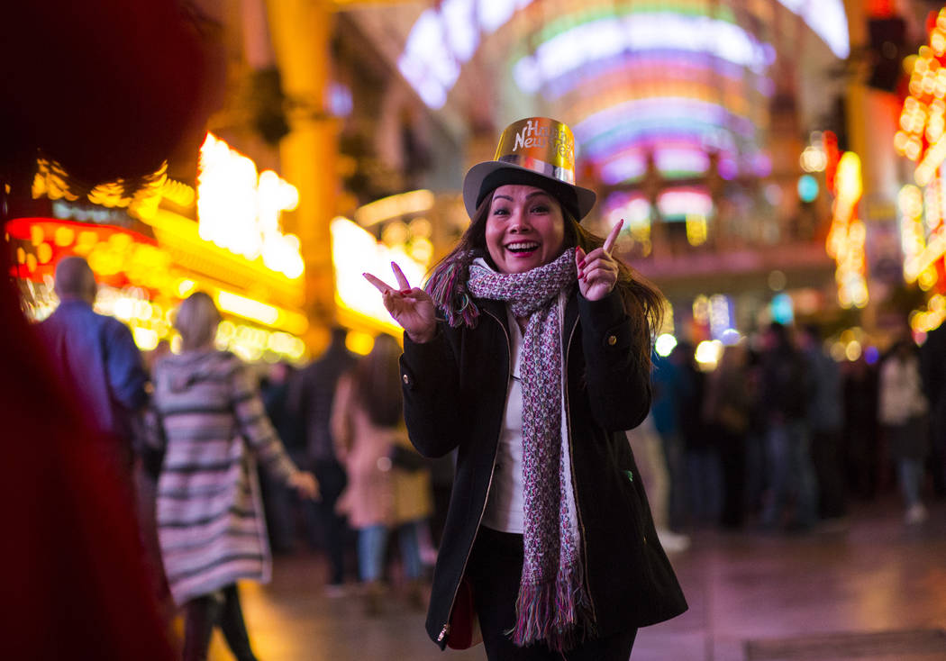 Tammy Dinh of San Diego, Calif., poses for a photo as New Year's Eve revelers gather at the Fremont Street Experience in downtown Las Vegas on Monday, Dec. 31, 2018. Chase Stevens Las Vegas Review ...
