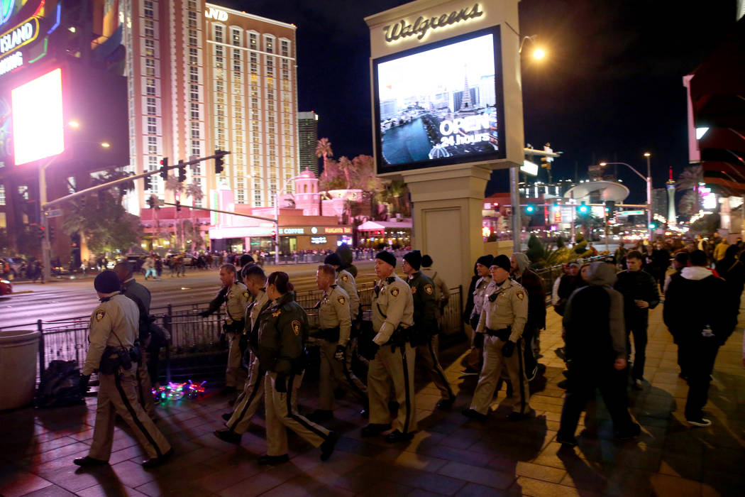 Las Vegas police officers walk on the north Strip on New Year's Eve in Las Vegas Monday, Dec. 31, 2018. K.M. Cannon Las Vegas Review-Journal @KMCannonPhoto