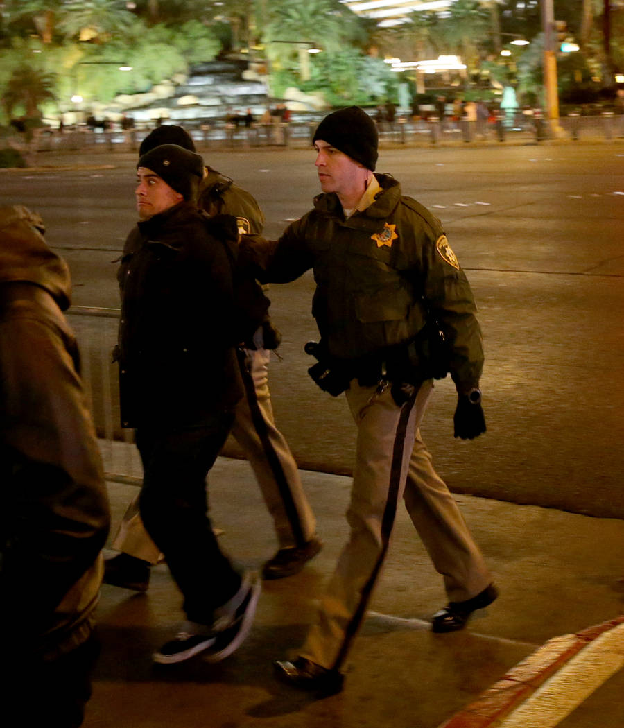 Las Vegas police detain a reveler who had a backpack on the north Strip on New Year's Eve in Las Vegas Monday, Dec. 31, 2018. K.M. Cannon Las Vegas Review-Journal @KMCannonPhoto