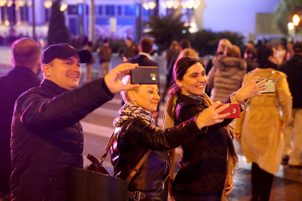 Revelers from Romania take photos on the north Strip on New Year's Eve in Las Vegas Monday, Dec. 31, 2018. K.M. Cannon Las Vegas Review-Journal @KMCannonPhoto