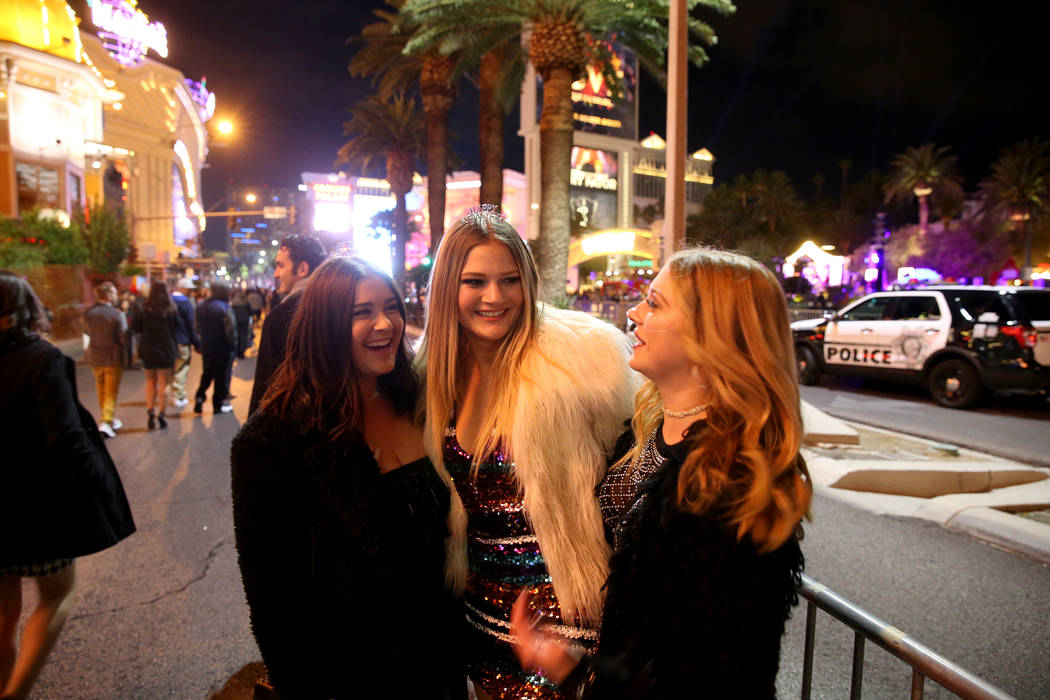 Sam Rosenthal, 21, from left, Lauren Bradley, 21, and Lauren Gragson, 21, all of Las Vegas, visit on the north Strip on New Year's Eve in Las Vegas Monday, Dec. 31, 2018. K.M. Cannon Las Vegas Rev ...