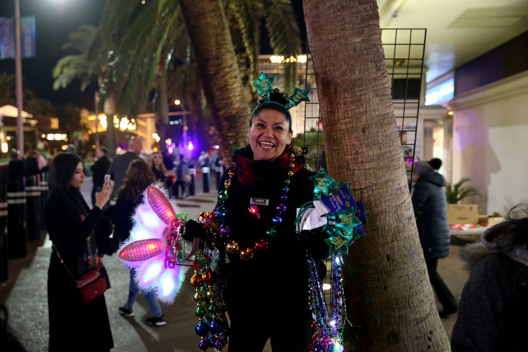 A vendor who declined to give her name sells merchandise on the north Strip on New Year's Eve in Las Vegas Monday, Dec. 31, 2018. K.M. Cannon Las Vegas Review-Journal @KMCannonPhoto