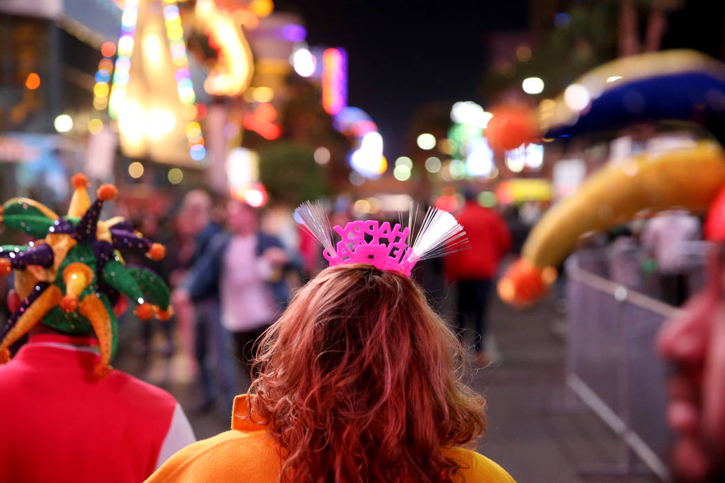 Revelers walk on the north Strip on New Year's Eve in Las Vegas Monday, Dec. 31, 2018. K.M. Cannon Las Vegas Review-Journal @KMCannonPhoto