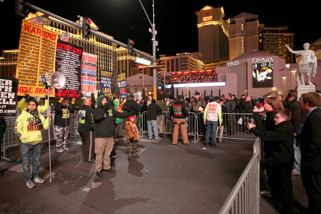 People give a religious message on the north Strip on New Year's Eve in Las Vegas Monday, Dec. 31, 2018. K.M. Cannon Las Vegas Review-Journal @KMCannonPhoto