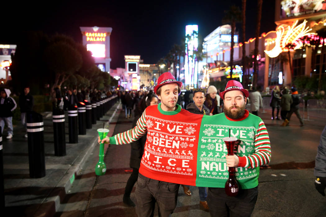 Dan Davies, 29, of England, left, and Max Taylor Grant, 27, of Scotland, party on the Strip on New Year's Eve in Las Vegas Monday, Dec. 31, 2018. K.M. Cannon Las Vegas Review-Journal @KMCannonPhoto