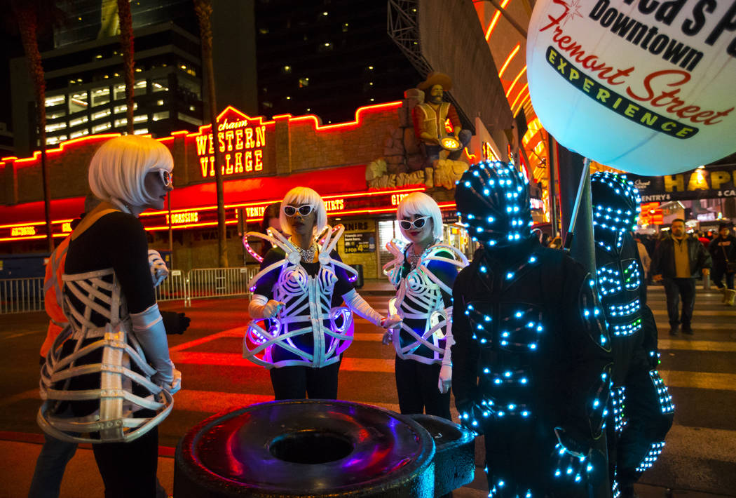 Costumed performers get ready to walk the Fremont Street Experience as New Year's Eve revelers gather in downtown Las Vegas on Monday, Dec. 31, 2018. Chase Stevens Las Vegas Review-Journal @csstev ...
