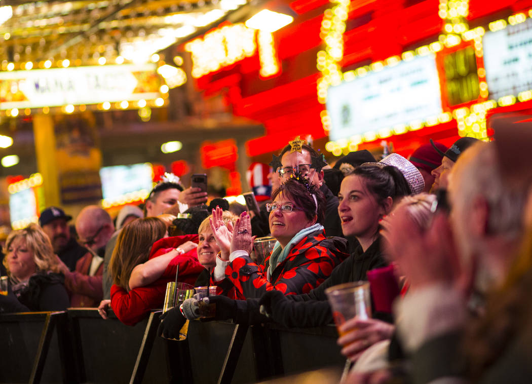 New Year's Eve revelers listen to a band perform along the Fremont Street Experience in downtown Las Vegas on Monday, Dec. 31, 2018. Chase Stevens Las Vegas Review-Journal @csstevensphoto
