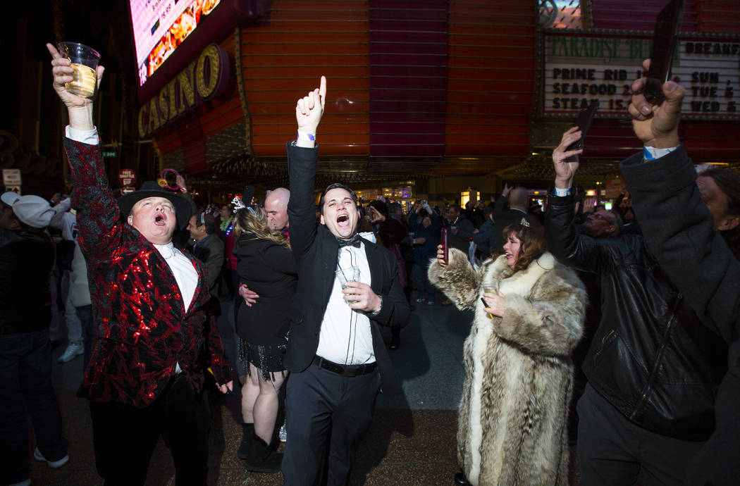 Revelers, including Shane Arnold, left, and Jeanie Arnold, right, both of Phoenix, celebrate the new year at the Fremont Street Experience in downtown Las Vegas on Tuesday, Jan. 1, 2019. Chase Ste ...