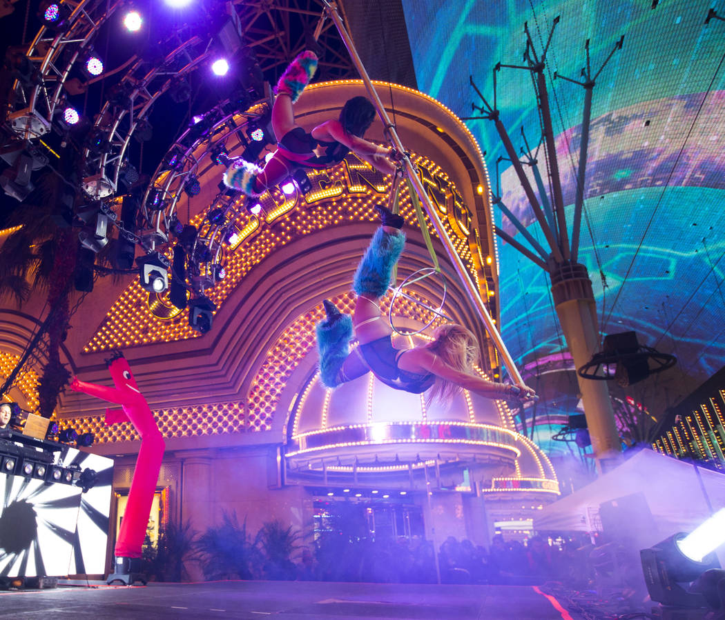 Performers entertain on stage as New Year's Eve revelers gather at the Fremont Street Experience in downtown Las Vegas on Monday, Dec. 31, 2018. Chase Stevens Las Vegas Review-Journal @csstevensphoto