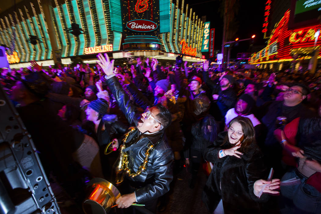Anselmo Garcia, center, reacts as New Year's Eve revelers gather at the Fremont Street Experience in downtown Las Vegas on Monday, Dec. 31, 2018. Chase Stevens Las Vegas Review-Journal @csstevensphoto