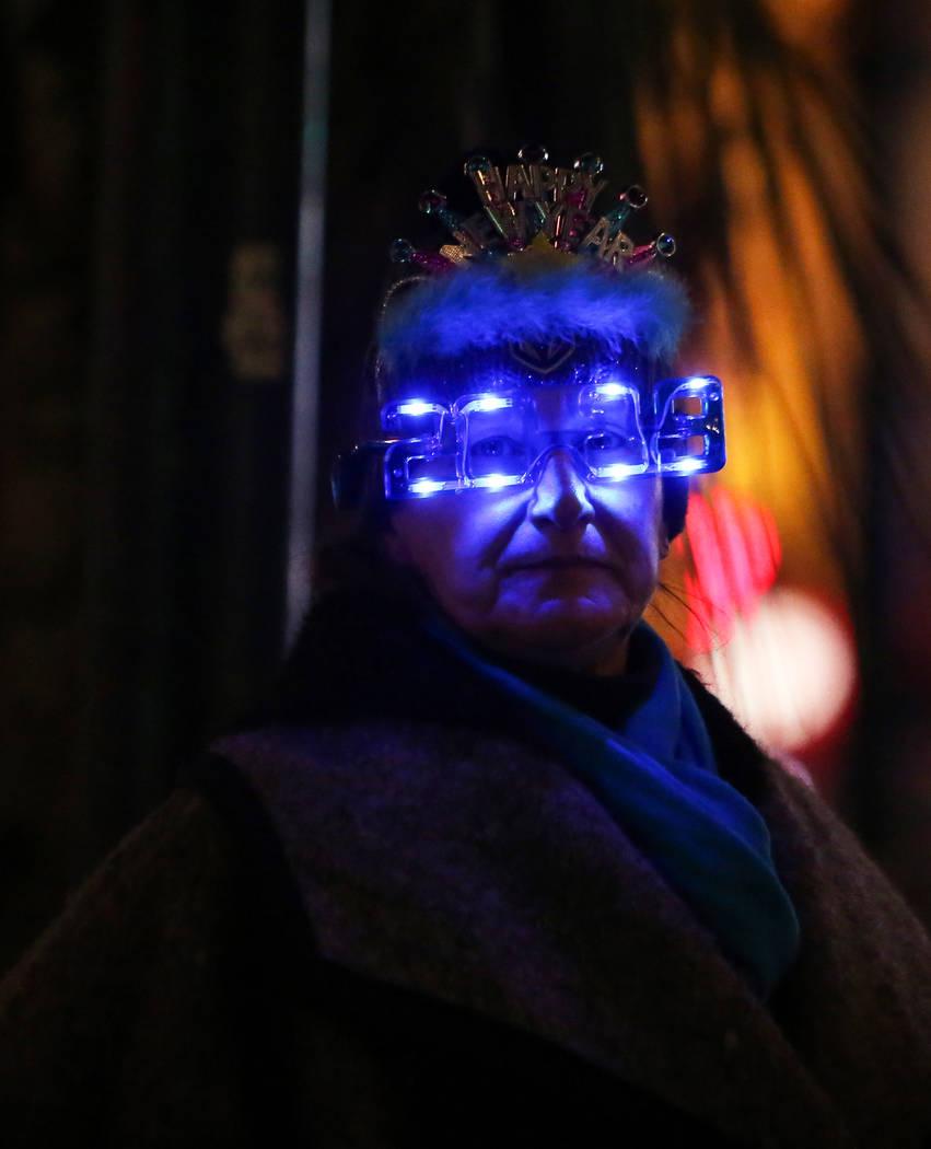 Mary Borlik from Los Angeles, Calif. wears 2019 glasses on the Strip in Las Vegas, Monday, Dec. 31, 2018. Caroline Brehman/Las Vegas Review-Journal