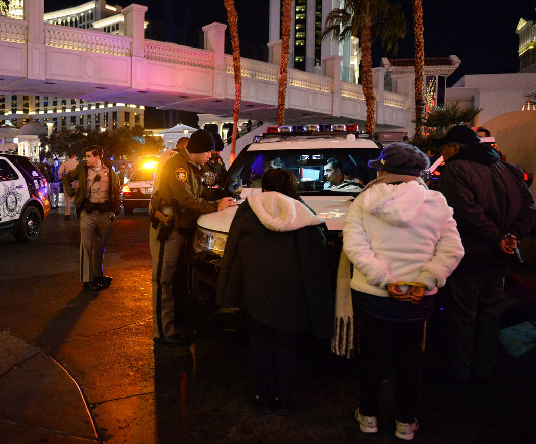 Police make arrests early on in the night on the Strip in Las Vegas, Monday, Dec. 31, 2018. Caroline Brehman/Las Vegas Review-Journal