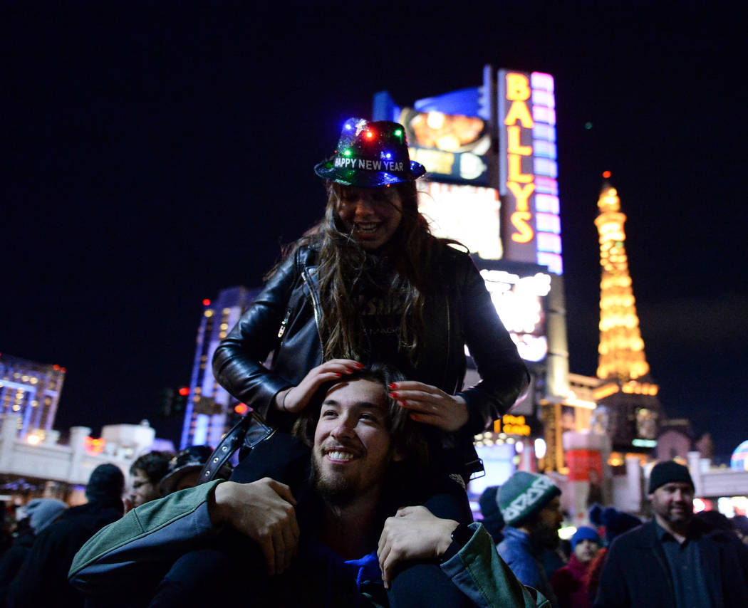 Sydney Stengs holds Ramona de Boer from the Netherlands on his shoulders on the Strip in Las Vegas, Monday, Dec. 31, 2018. Caroline Brehman/Las Vegas Review-Journal