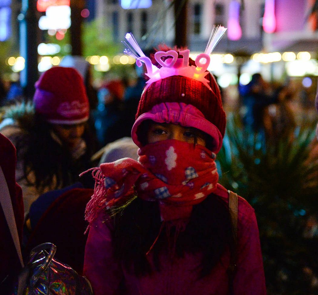 Ingrid Negrete, 10, from San Diego bundles up for the cold weather on the Strip in Las Vegas, Monday, Dec. 31, 2018. Caroline Brehman/Las Vegas Review-Journal