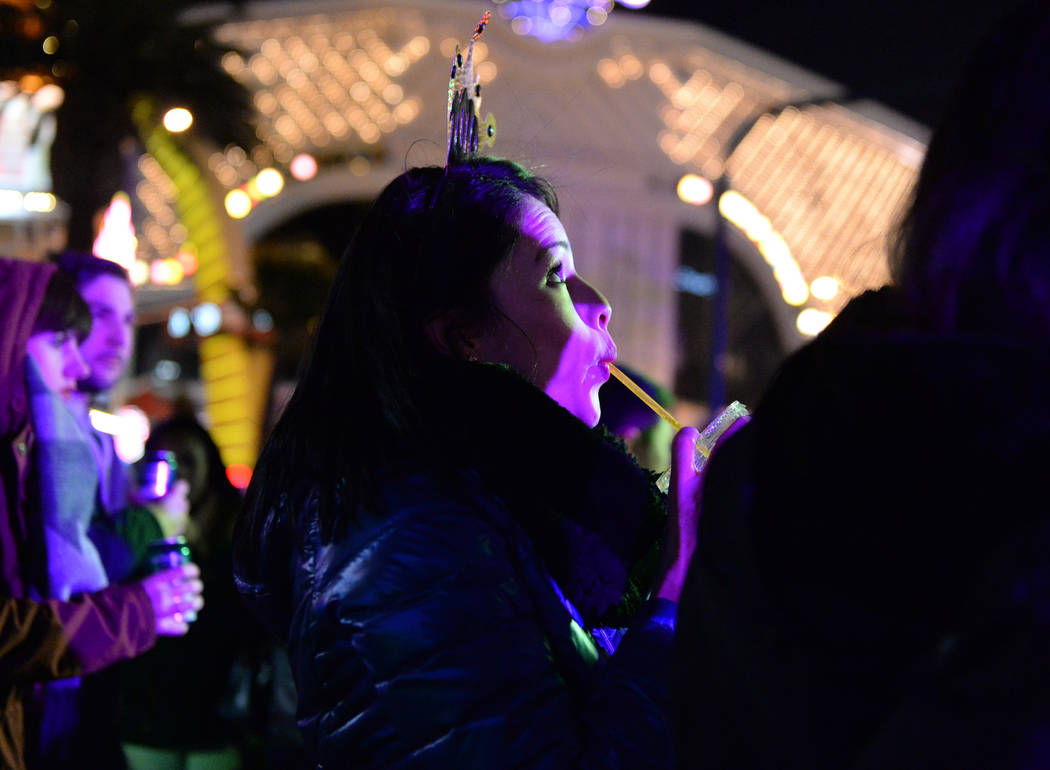 Egleth Ramos from Columbia takes a sip from her drink on the Strip in Las Vegas, Monday, Dec. 31, 2018. Caroline Brehman/Las Vegas Review-Journal