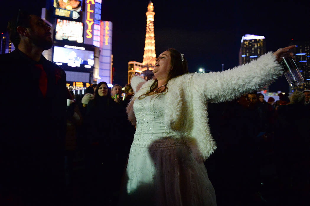 Sean Trammell, left, and Katie Trammell from Atlanta after getting married earlier today dance together on the Strip in Las Vegas, Monday, Dec. 31, 2018. Caroline Brehman/Las Vegas Review-Journal]