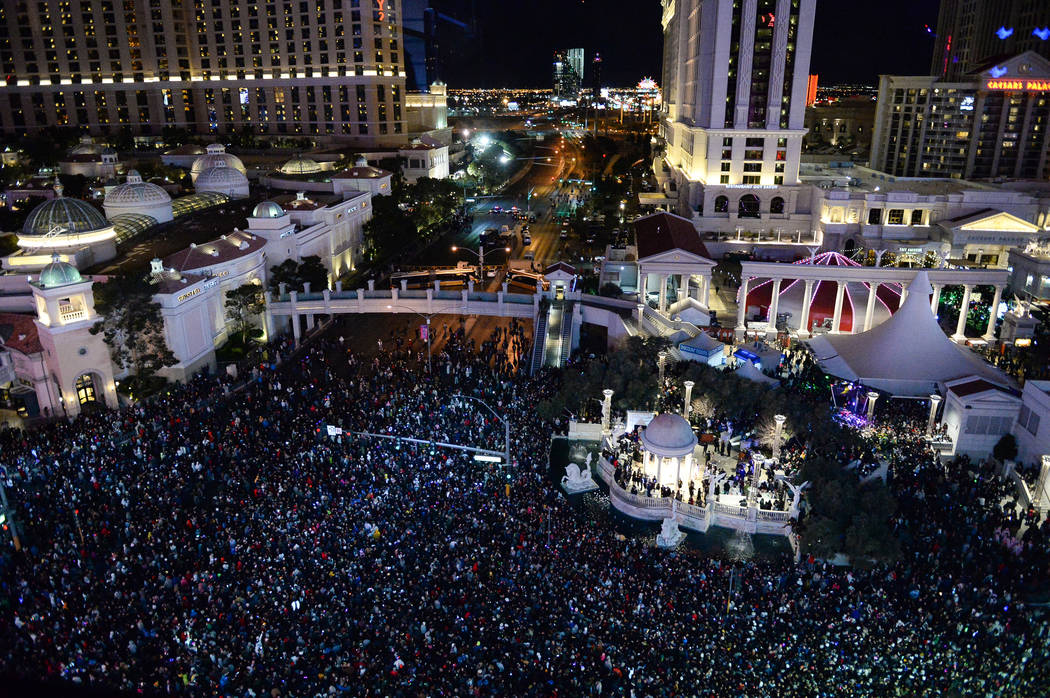 People gather to watch the fireworks go off for the New Year as seen from Drai's Nightclub on the Strip in Las Vegas, Tuesday, Jan. 1, 2019. Caroline Brehman/Las Vegas Review-Journal